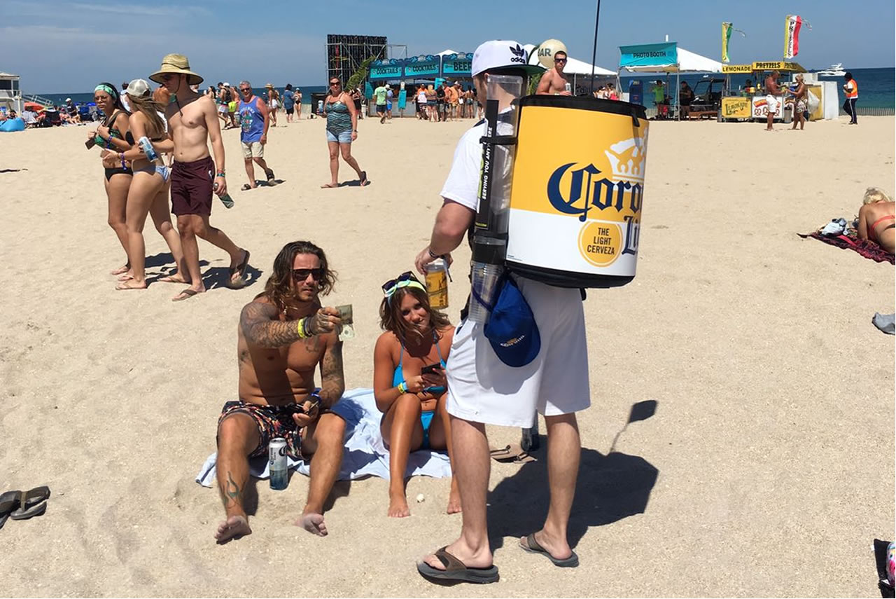 2DRINK serving Corona beer at the beach